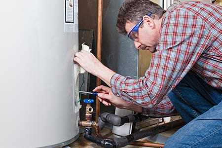Water Heater Repair Man Fixing